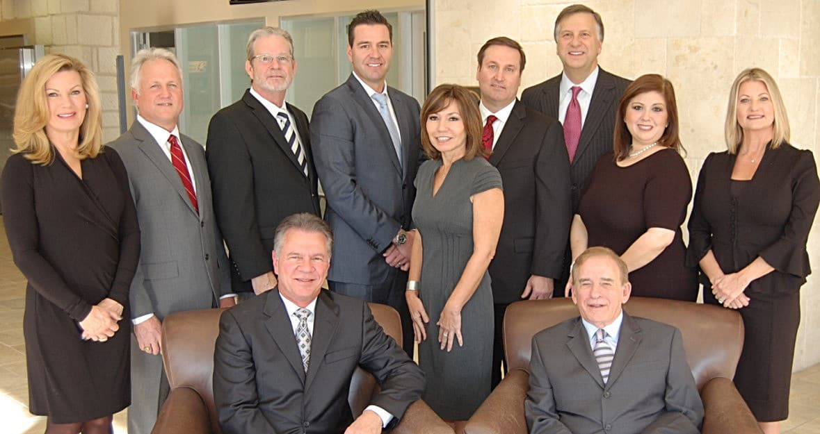 The Beck Capital Management team posing for a group shot - Austin Investment Advisors - Beck Capital Management